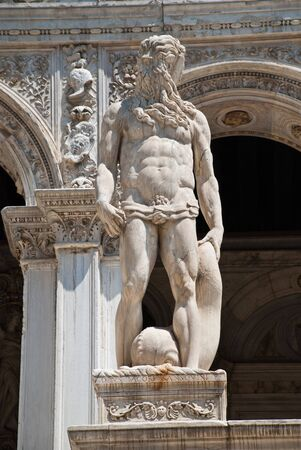 Venice, Italy: A statue of Neptune - The Roman God of the Sea, located at the Giants Staircase at the Doges Palace (Palazzo Ducale). The statue represents Venice's power by sea