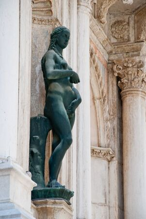 Venice, Italy: Bronze statue of Eve on the facade of Arco Foscari, Doge's Palace, courtyard