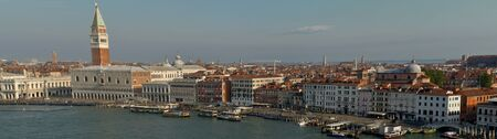 Venice, Italy: aerial view from Giudecca Canal to the Piazza San Marco with Campanile and Doge's Palace, panorama picture Stock Photo