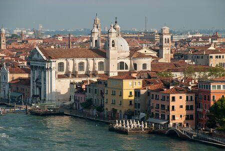 Venice Italy: Aerial view of Dorsoduro district, Santa Maria del Rosario church, waterfront Giudecca canal, promenade