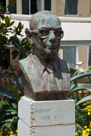 Corfu town, Greece: Bust of the former Prime Minister of Greece Georgios Ionnias Rallis, nearby Liston and Spianada Foto de archivo
