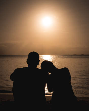 Couple in a romantic beach sunset