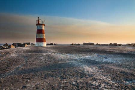 image created 21st century: Tiny Lighthouse at Sunset Stock Photo