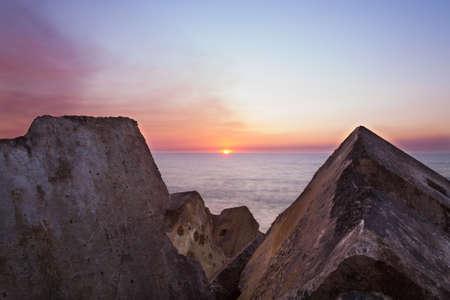 image created 21st century: Sunset between the rocks