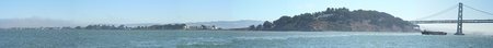 A wide angle picture of the western side of the San Francisco Bay Bridge and Treasure Island.