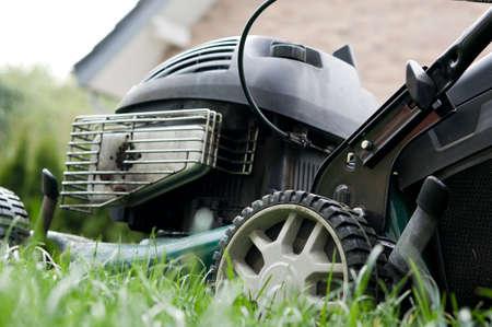 lawn mower cutting grass photo