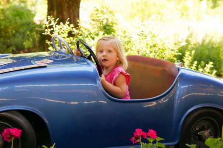 fun fair: little girl in a fun fair drive car