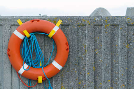 hanging life buoy on the wall photo