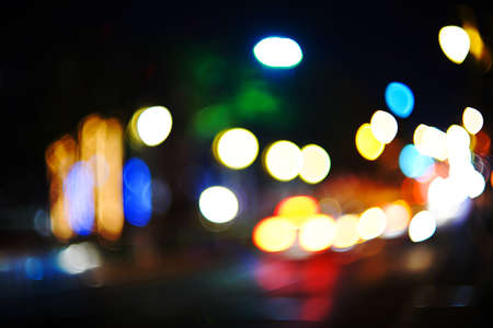 pass away: light in the night was out of focused and have cars pass away by manual lens. Stock Photo