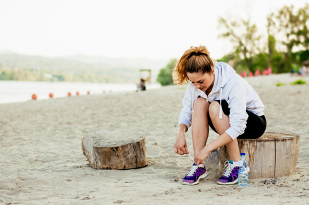 Girl preparing for the training outdoor