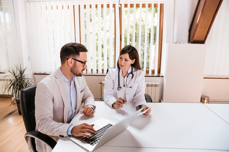 Female doctor discussing with manager. Stockfoto