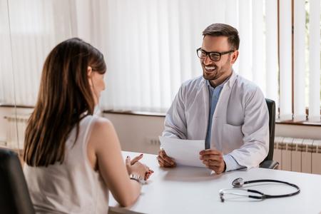 Doctor explaining prescription to patient, healthcare concept