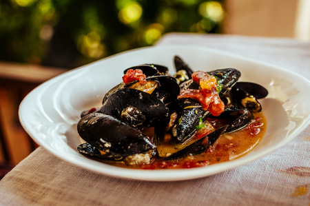 Boiled mussel in a bowl. Stock Photo