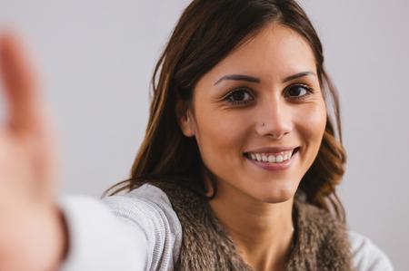 Pretty girl taking selfie. Stock Photo