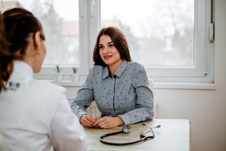 Beautiful girl is consulting with gynecologist Standard-Bild