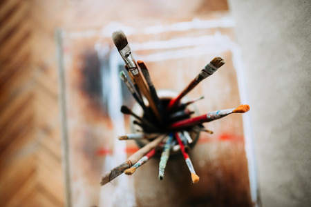 Top view of artist's brushes in a jar.