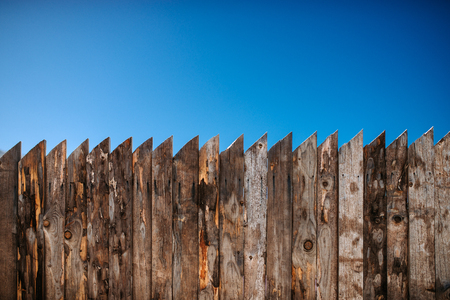 Old wooden fence and clear sky.