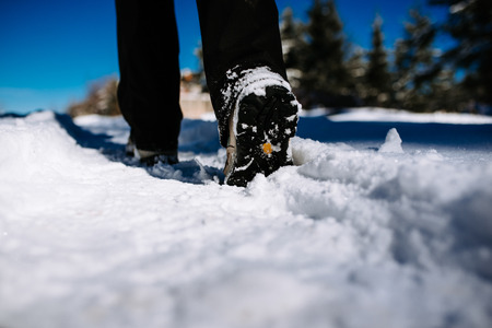 Hiking on the mountaintop covered with snow. Low angle view