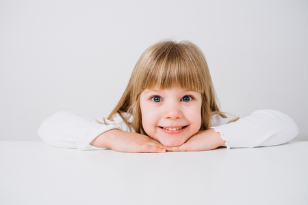 Portrait of a beautiful little girl looking at camera. Isolated background.