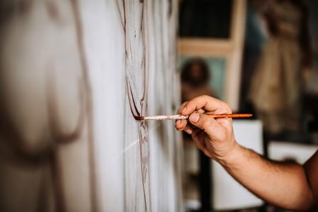 Painter working on artwork.