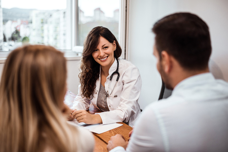 Family couple sitting in doctor's office at consultation. Standard-Bild - 98421757