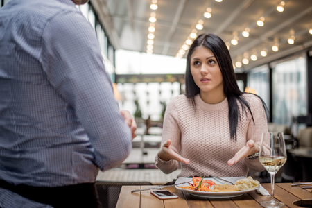 Portrait of woman complaining about food quality and taste in restaurant.