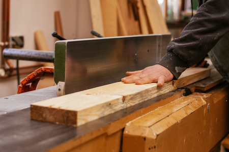 Craftman using wood for his next job