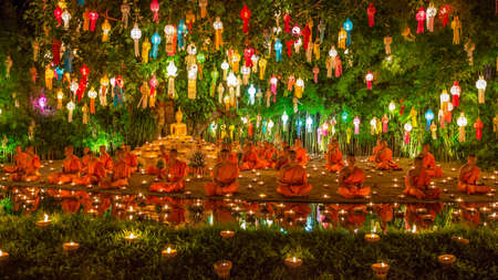 Wat Phan Tao, Chiangmai - November 9, 2014 : The monks come to take place praying and meditation on the Yee Peng  Festivals night. This festival is popular to the people and visitors to attend the event every year. Editorial