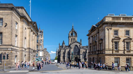 mile: Edinburgh, Scotland - Jul 1, 2014 :  Crowded people are spending their vacation in a sunny day at St Giles Cathedral on Royal Mile in Edinburgh, Scotland. Editorial