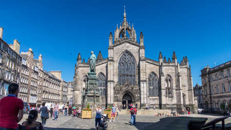 giles: Edinburgh, Scotland - Jul 1, 2014 :  Visitors are spending their vacation in a sunny day at St Giles Cathedral on Royal Mile in Edinburgh, Scotland. Editorial