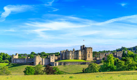 Alnwick Castle, a castle and stately home in Alnwick in the English county of Northumberland. Редакционное