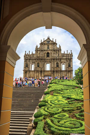 Macau, China - Jun 1, 2015 : Tourists are taking pictures at the Ruins of St. Paul Cathedral during the raining day. Editorial