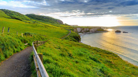 Coast with green grass nearby a carrick-rede-rob, Northern Ireland, UK. Stock Photo