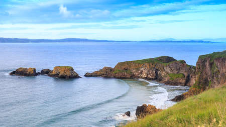 Carrick-a-Rede Rope Bridge  is a famous rope bridge near Ballintoy in County Antrim, Northern Ireland. The bridge links the mainland to the tiny island of Carrickarede.