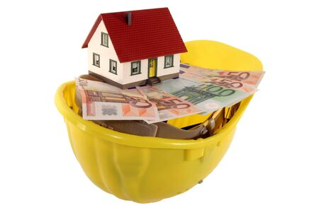 funded: House on Euro banknotes and helmet