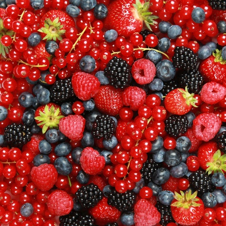 currants: On a table are lying strawberries, bilberries, red currants, raspberries and blackberries Stock Photo
