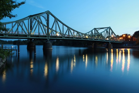 iron curtain: The Glienicker Bridge (German Glienicker Bruecke) goes over the Havel river and connects Potsdam with Berlin. It was part of the iron curtain.