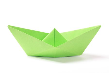 Closeup of a green paper boat on white background Stock Photo - 11258923