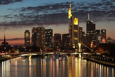 main river: Skyline of the German financial center Frankfurt in the evening