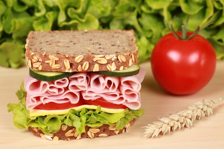 ham sandwich: Fresh sandwich with ham, cheese and lettuce on a wooden table