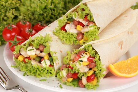 Chicken wrap sandwiches filled with beans, lettuce and corn photo