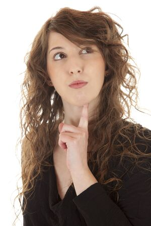 An attractive young woman is thinking by holding a finger on her chin Stock Photo - 14516011