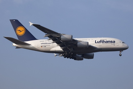 Airbus A380-800 aircraft of German Airline Lufthansa with the registration D-AIMF and the name Zurich on approach to Frankfurt Airport
