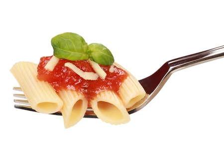 pasta dish: Fresh pasta on a fork is served with tomato sauce, basil and cheese. Stock Photo