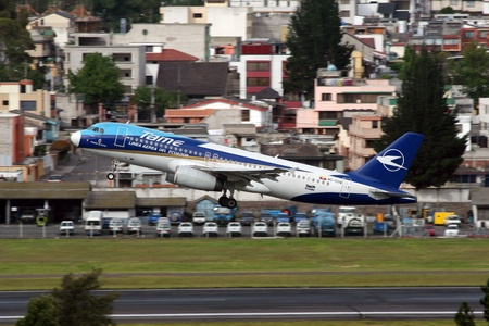 rea: Quito, Ecuador - June 16, 2011: A TAME Airbus A320 jet airliner with the registration HC-CGW takes off from Quito International Airport (UIO) in Ecuador. TAME – Línea Aérea del Ecuador is the national airline of Ecuador with its headquarters in Quito. It