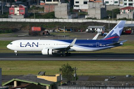 quito: Quito, Ecuador - June 16, 2011: A LAN Boeing 767 jet airliner with the registration HC-CJX taxis on Quito International Airport (UIO) in Ecuador. LAN Airlines is the flag carrier of Chile based at Santiago Airport. It operates with 117 jet airliners and c