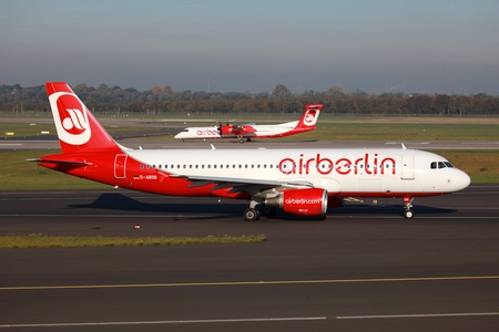 Dusseldorf, Germany - October 21, 2011: An Air Berlin Airbus A320 taxis to takeoff position. Air Berlin is Germanys second largest airline with some 144 planes and 35.3 million passengers in 2011. Dusseldorf airport is one of its main hubs.