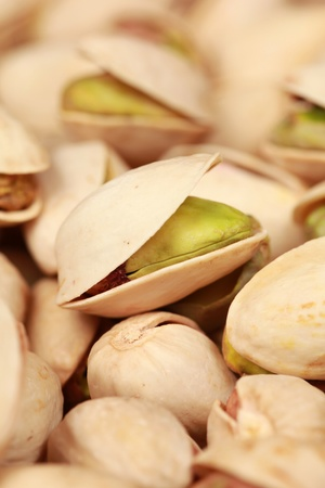 pistachios: Many pistachios one upon another forming a background Stock Photo