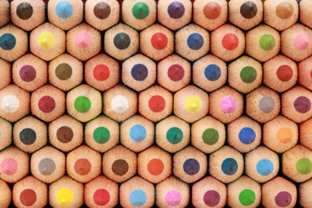 coloured pencil: Colored crayons in a stack showing their tops.  Stock Photo