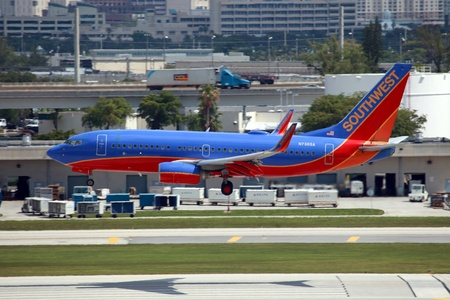 Fort Lauderdale, Florida - May 10, 2012: A Southwest Airlines Boeing 737 approaches Fort Lauderdale Airport in Florida. Southwest Airlines is the worlds second largest airline and the largest low cost airline with 708 planes and 106.2 million passengers